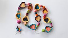 This boho heart garland looks stunning in any setting. It is strung together with colourful wooden beads to bring a cheery feel to your decor