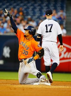 Carlos Gomez #30 of the Houston Astros doubles and drives in a run against the New York Yankees in the first inning during their game at Yankee Stadium