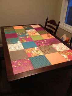 Decoupaged Table - like the idea but think I would paint the table white and colour theme the patterns a bit more