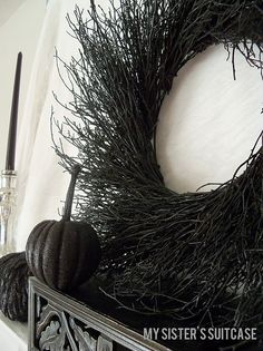 Spray paint a dollar store twig wreath black for Halloween