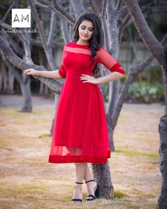 Anupama Parameswaran stills in red dress for launching Mission Interstellar at Wonderla,tollywood new actress,malayalam actress,south hot actress stills Frock Design, Kurta Designs Women, Salwar Designs, Designer Kurtis, Frock Fashion, Fashion Dresses, Trendy Dresses, Long Dresses, Maxi Dresses