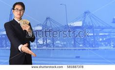 Double exposure businessman shaking hand on blurred port cargo crane container background. business concept.