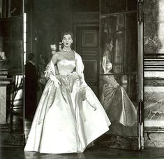 Fiona Campbell-Walter wearing a duchesse satin ball gown by Balenciaga.    Photographed by Frances McLaughlin-Gill at Versailles for Vogue 1952