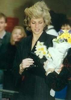 Diana, Princess of Wales, in London, 1988, receiving flowers from members of the public