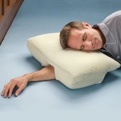 A pillow that solves your annoying side-sleeping arm problems.