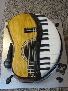 Music lovers cake! It is art to me... The microphone is all chocolate.  The rest is chocolate mud cake decorated with fondant and modelling chocolate.