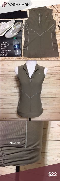 Nike Quarter-Zip Tank / Vest Charcoal gray Nike vest / tank in excellent condition. Dry fit material is super stretchy and comfortable. Quarter zip with a sleek collar. Tagged size medium but in my opinion it's more size small depending on how tight you prefer your workout gear. (Pictured on a size small mannequin for reference). Nike Tops