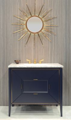 Amora vanity by Ronbow (navy w/ gold inlay).  Tamalpais faucet. Aliso handles by California Faucets.