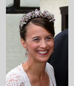 Princess Xenia wearing the Hohenlohe-Langenburg Floral Tiara, Germany (19th c.; pink topazes; diamonds). The colored gemstones are probably pink topazes, but may be pink diamonds, pink sapphires, or even pale amethysts.