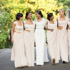 Bridesmaids looking lovely in white sarees.