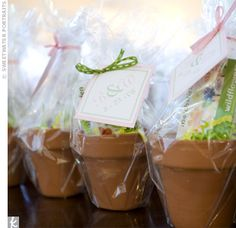 I'm thinking of using a packet of flower seeds as the escort card. Then when the guest arrives to their seat a little flower pot for them to plant their flowers.