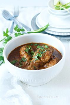 """Indian Chicken Curry -- Curry literary means a """"dish with a sauce,"""" curry is not a dish by itself. You add the name of the key ingredient before curry and voila you have the name of the dish…Chicken Curry, Mixed Vegetable Curry, Lamb Curry and so on. Adding a spoon or two of store bought curry powder to a dish is far from anything authentic. A true home-style Indian curry is a beautiful symphony of simple flavors and spices"""