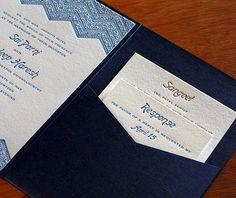 Blue and gold chevron wedding invitation set with matching blue pocket folder.    Invitations by Ajalon   invitationsbyajalon.com