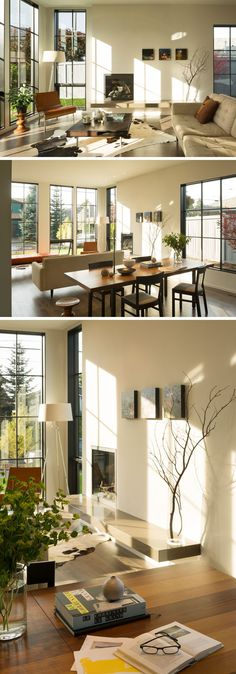 Stepping inside this contemporary home, the large grid windows flood the interior with natural light and provide views out onto the street. The living room, located at the front of the house, is focused on a built-in fireplace, while behind the couch is the dining area with a wood dining table.