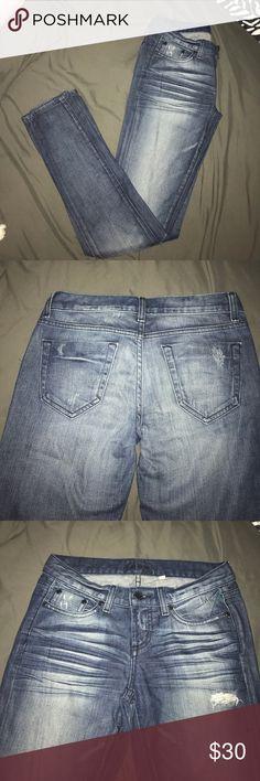 "Bebe distressed jeans 27 Bebe skinny jeans, dark wash, factory distress, stretch material. 14"" waist, 7 1/4"" rise, 31 1/2"" inseam. bebe Jeans Skinny"
