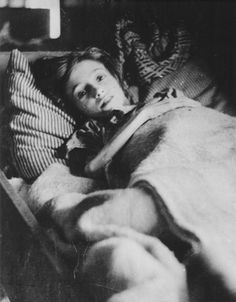 12 year old Helena Rabbie lies in bed in a newly liberated barracks at Bergen-Beslen concentration camp. Of the 22,000 women and 18,000 men rescued from the camp, 15,000 were suffering from Typhus. 1844 died of disease and malnutrition soon after liberation. Helena died eleven days after this picture was taken.