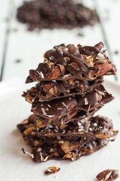 {Coffee roasted almond and toasted coconut dark chocolate bark.} First make mocha coffee almonds.  Ingredients  1 1/2 cups whole raw almonds,  1 cup pistachios,  1/2 cup fresh ground coffee beans,  1 T unsweetened cocoa powder,  2 T coconut oil,  1 tsp vanilla extract,  1/2 tsp sea salt,  16 ounces dark chocolate, chopped, divided,   1 1/2 cups unsweetened flaked coconut, toasted,   flaked sea salt, for topping