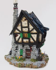 https://flic.kr/p/q6ChAb | Blacksmith Shop | What does every castle need? Obviously it's a blacksmith. maybe even two. Really depends on how quickly your knights are blunting their swords trying to kill make belief dragons. CCC XII - Castle Building A remake of the classic (is it classic yet?) set brickset.com/sets/3739-1/Blacksmith-Shop I tried to keep the character of an angular house, without making it look like its decaying, along with keeping the simple retro feel of the set…