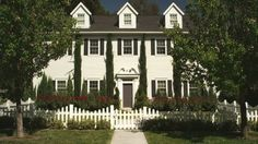 Hanna's house from Pretty Little Liars, classic colonial with a white picket fence...the image of perfection lol and quite expensive