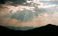 Sun rays through clouds. Coolest pictures of the skies is when God touches the earth with His fingertips.