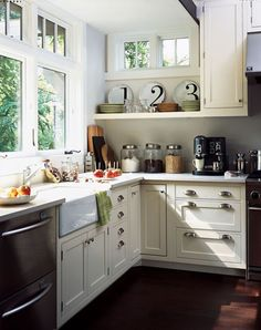 love the small windows over the shelf and the drawer pulls.    (Urban bungalow kitchen by architect Michaela Mahady.)