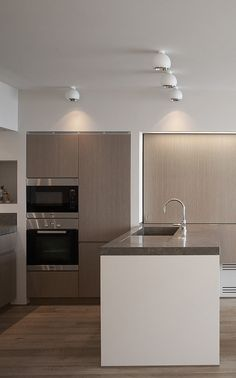 i like the idea of doing two materials for the main kitchen. a white and a wood.
