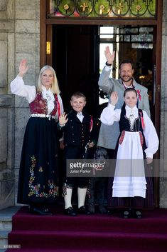 (NORWAY OUT) Crown Prince Haakon, and Crown Princess Mette-Marit of Norway, with their children Princess Ingrid Alexandra, and Prince Sverre Magnus, and their family pet dog, Milly Kakao, attend the traditional morning children's parade, at their home, Skaugum, in Asker, near Oslo, on Norway's National Day, on May 17, 2016 in Oslo, Norway. (Photo by Julian Parker/UK Press via Getty Images)