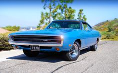 1970 Dodge Charger---Looks like the car my favorite ex had while we were dating, only dark green. He let NO ONE drive it...but it musta been love. He let ME drive this beauty! Omg, how I loved it! Classic! I'll never forget that car. Or him. :D
