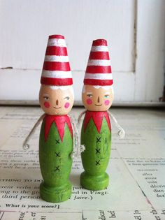 this listing is for ONE elf.  these little guys are so fun... i love their festive colors and stripes... and those tiny chenille arms!    part of my wooden lulettes collection. wooden lulettes are created on wooden, vintage, weathered pins and toys... i give them new life with pencil, paints and old bits of this and that. (the arms are vintage chenille and can be removed if you wish!)  hand painted and distressed... sealed with a matte finish for protection. your new pal is just about 4…