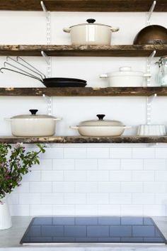 rustic wood shelving + white subway tile