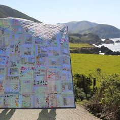 """As I mentioned in my last post, my husband (Dave/@statelytype) and I (and our good friends @honeyjanequilts & @jim.pig) spent last weekend in Monterey/Pacific Grove/Carmel/Big Sur. It is one of my favorite destinations in the world! I brought my latest quilt thinking I'd have so much time to finish binding it, but the scenery was too pretty to miss, so I was only halfway done with it when I hopped out to take this picture. And when I say """"I hopped out"""" I really mean, """"we all hopped out""""…"""