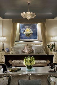 Nailhead around tray ceiling; stunning bedroom with beautifully lit artwork.