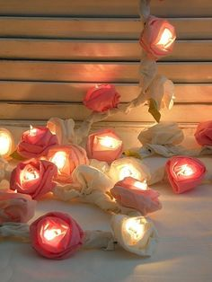 Ribbon Rose Flower Light Garland, Cottage Style, 50 Strand. So Doing this! I just bought them lights for the bed room