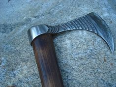 "Skeggjaortonn - Bearded tooth... Forged from a 3"" long piece of 1"" Sq 1080 the handle is Ash with a leather wrap. The engraving reads in dwarven (anglo saxon) runes in the common tongue a quote from J R Tolkien. ""there hammer on the anvil smote. the chisel clove , the graver wrote. there forged was blade and bound was hilt."" This Axe was made for the KITH (Knife in the hat) on the Bladesmithsforum.com... http://www.bladesmithsforum.com/index.php?showtopic=26091&p=247363"