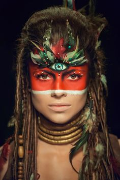 "wow, cultural appropriation bingo! feathers, check. ""third eye"", check. war paint, check. neck rings, check. locked hair, check. Amazing."