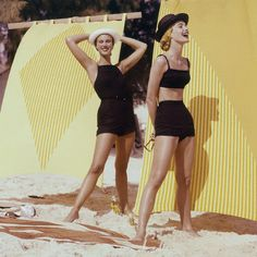 April 1956    Models wearing black jersey swimsuits: A two-piece suit by Greta Plattry and a one-piece by Reel Piose.