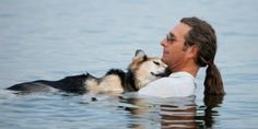 Tender moment between man & dog. Schoep, a 19-year old pooch has bad arthritis and every evening his owner, John Unger, takes him into Lake Superior to soothe him, cradling the elderly dog in his arms as he rocks him to sleep. The water is therapeutic for the dog's aching bones, Unger says. The Wisconsin man rescued Schoep nearly 20 years ago and the two have been together ever since.  (© Hannah Stonehouse Hudson/Stonehouse Photo, http://aka.ms/mandog)