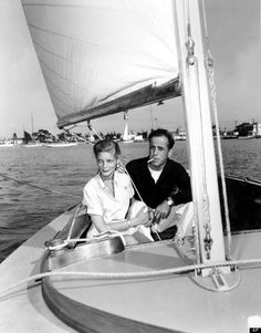 Actor Humphrey Bogart and his wife, actress Lauren Bacall, are shown on his 28-foot sailboat at Balboa Bay, Ca., on June 4, 1945. (AP Photo)