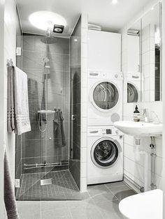 Färgsättning. Mörkare i dusch, ljusare golv och resten vitt. Snyggt!