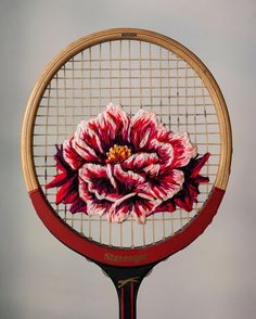 Embroidered flowers on the strings of vintage rackets by South African artist Danielle Clough today on Yatzer.com Photo © Danielle Clough.