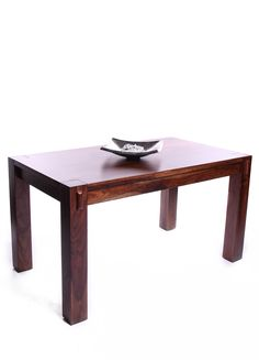 Very solid mango wood dining table.