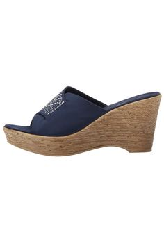 Make a fashion statement with the Kaelyn wedge by Onex. Pair with a sundress or even jeans for a more casual look. Lightly padded sole for added comfort; Slide in entry for easy on and off; Fabric upper and decorative stud accents for style. Runs slightly small; If you're a half size go up to the whole size. US Sizing.     Platform Height: 1 1/4 inch Heel Height: 3 1/2 inches   Kaelyn Wedge Sandal by Onex. Shoes - Wedges Branford, Connecticut