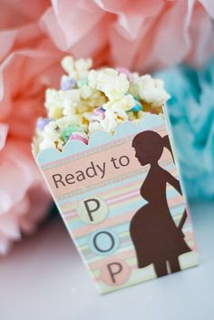 "Baby shower favors. popcorn with m's and melted white chocolate morsels.  I couldn't find the boxes at hobby lobby so I used mini paper bags and printed my own sticker (using avery address labels) that said ""ready to pop"" for Anne's shower. YUM"