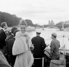 Romy Schneider in Chanel at a party on a boat for the Italian film Boccaccio '70