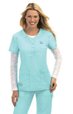 Our unique new button-front top. 3 buttons at neckline Unique crisscross eyelet detail on 2 pockets Flattering fit Double needle stitching at sleeves and hemlin Koi Scrubs, Medical Uniforms, Scrub Pants, Scrub Tops, Work Wear, Hemline, Tunic Tops, Sleeves, Clothes