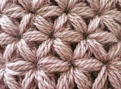 Crochet tutorial that teaches you how to do the Jasmine Stitch. This crochet stitch uses puff stitches to create a More