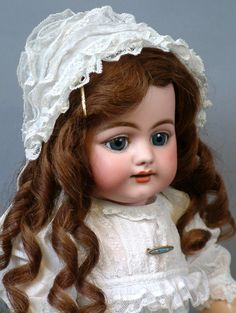 """Smiling 719 Simon & Halbig Character Child Antique Doll 22"""". CONDITION: Generally Excellent. The finest quality, powdery soft pale bisque head with deep and crisp modeling, expert painting of features, pleasant subtle coloring, enhanced with wonderful almond cut blue sleep eyes and antique wig."""