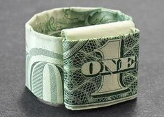 How to Fold a Dollar Bill RingYou can find Dollar origami and more on our website.How to Fold a Dollar Bill Ring Money Origami Heart, Origami Ring, Origami Gifts, Origami Ball, Origami Bookmark, Origami Folding, Paper Crafts Origami, Origami Hearts, Origami Boxes
