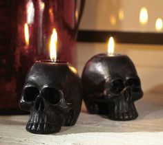 Black Mini Skull Shaped Candle... create a dark and eerie spectacle with a black skull candle (3.75 x 2.5 x 3; 9.50) || Pottery Barn
