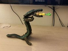 Paracord Crocodile.  My son reshaped him and added a little treat. He gave him a new name Parazilla!